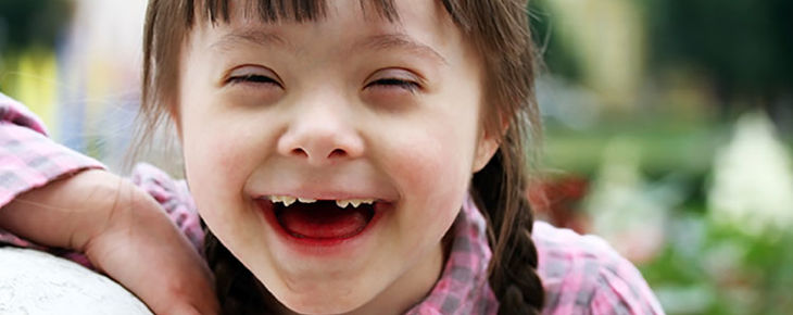 A girl with Down syndrome having fun